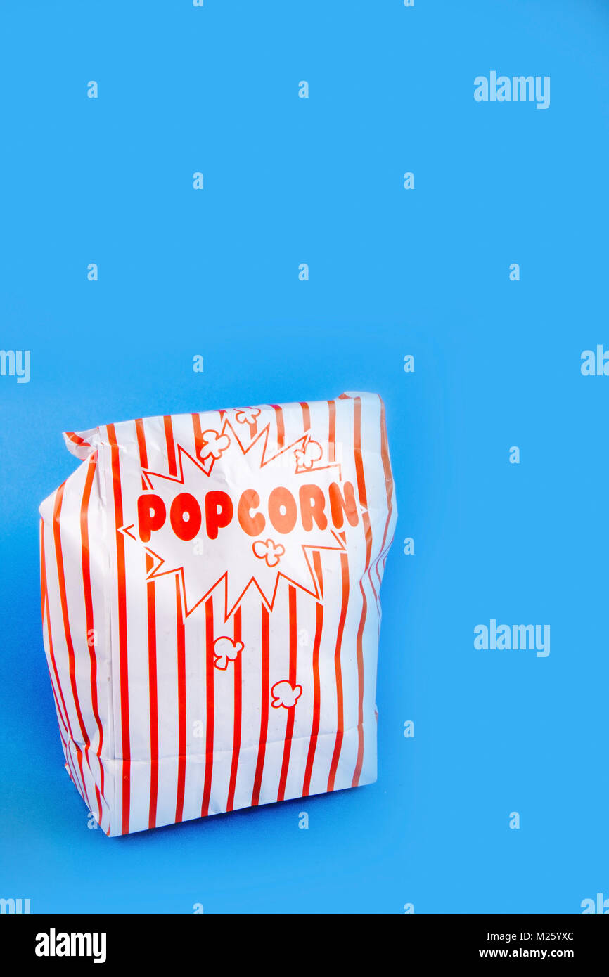 A bag of popcorn concept for cinema, theatre or watching any form of entertainment - Stock Image