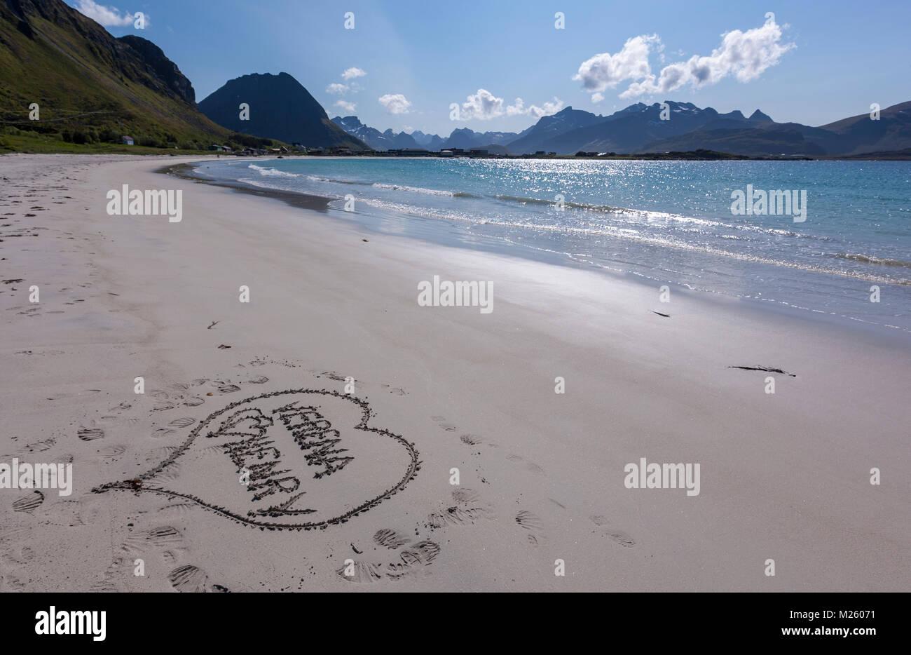 Love heart written in the sand of Ramberg Stranda, beach in Jusnesvika bay. island of Moskenesøya, Lofoten - Stock Image