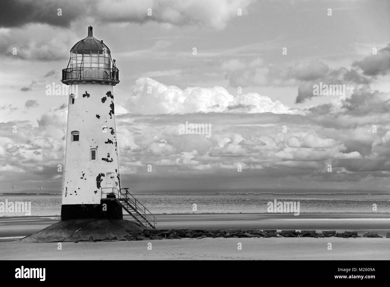 Point of Ayr Lighthouse stands at the mouth of the Dee Estuary in Wales near Talacre village. It was built in 1776 - Stock Image