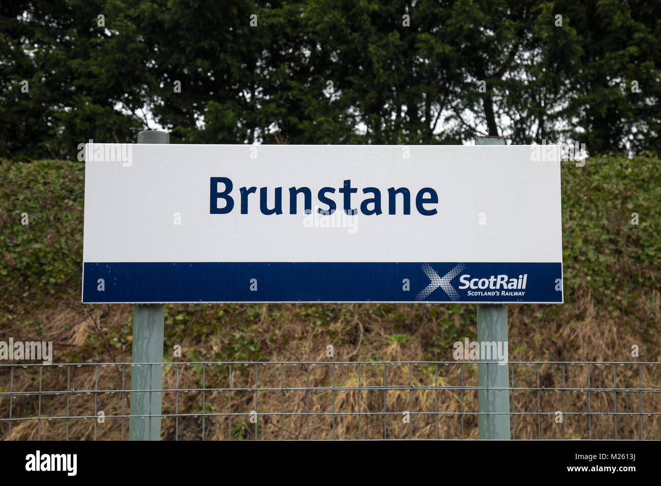 The railway station sign at Brunstane in Edinburgh. This is one of the few stations in Scotland that has no Gaelic - Stock Image