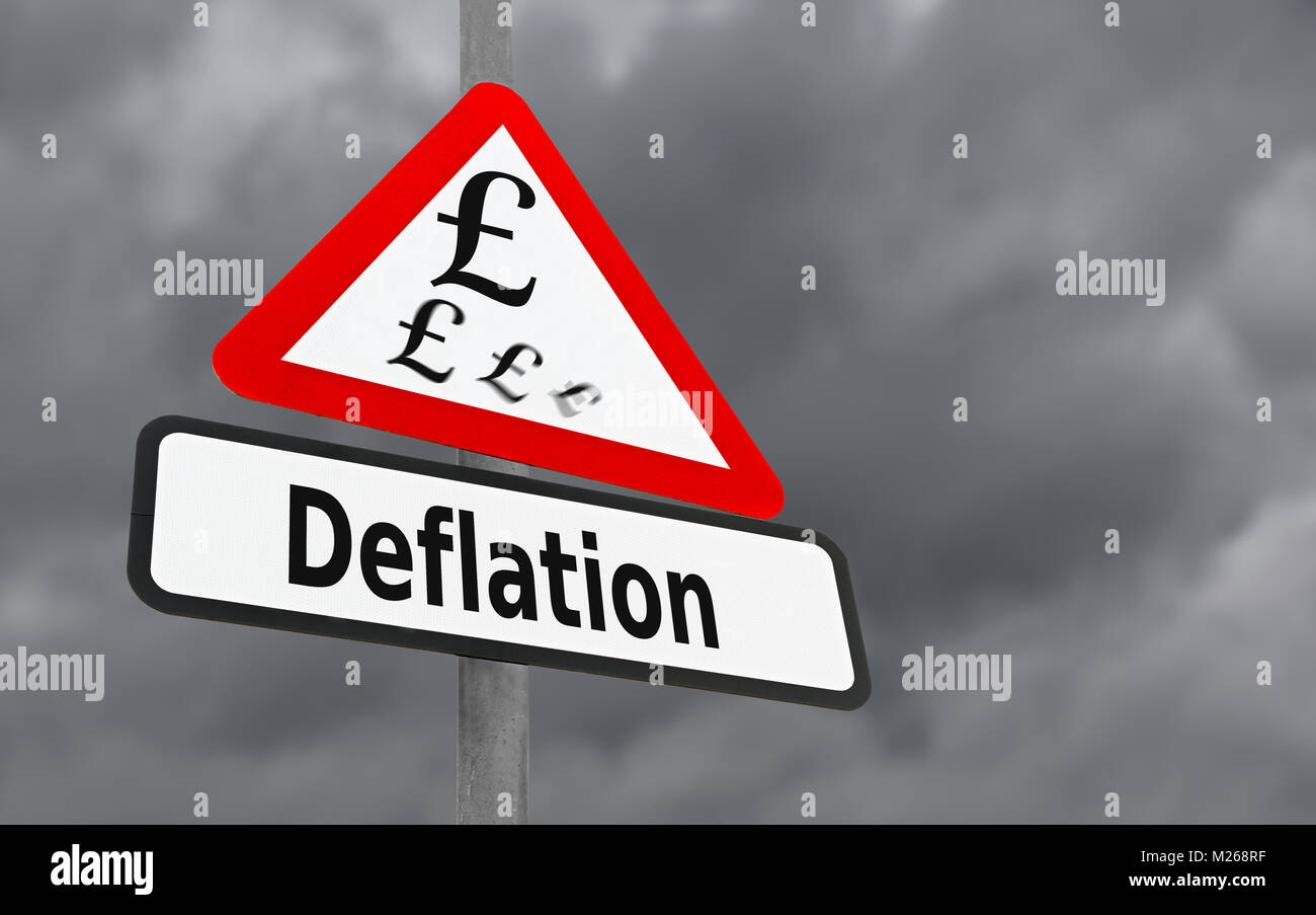 Deflation sign. Signpost showing the concept of a deflating economy where prices and inflation are moving in a downwards - Stock Image