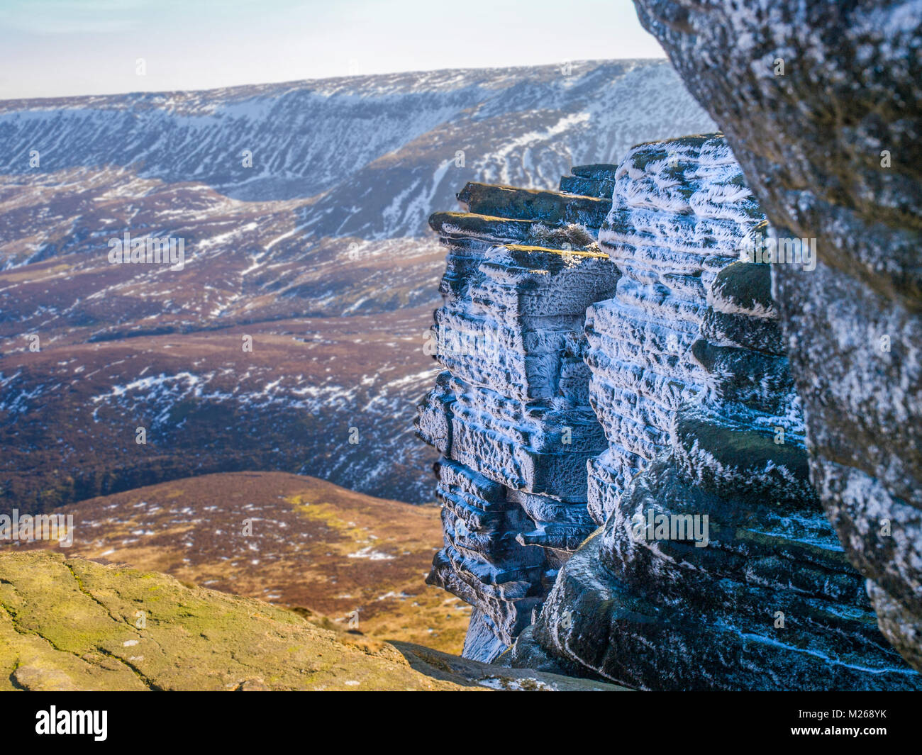 The crags on the Northern Edges of Kinder Scout, Peak District National Park with ice and snow - Stock Image