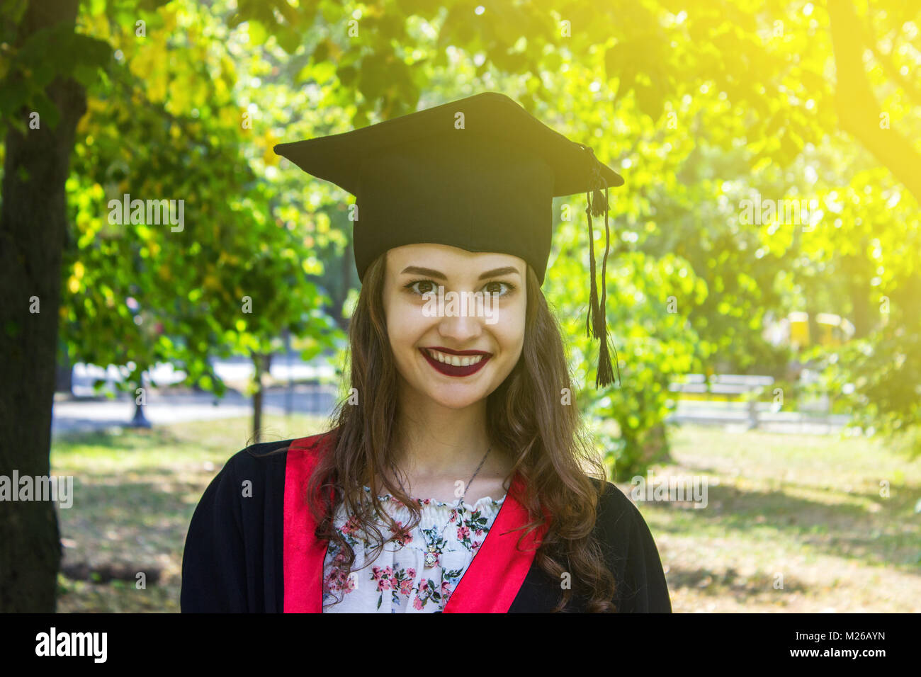 Happy woman on her graduation day. University, education and happy people - concept. - Stock Image