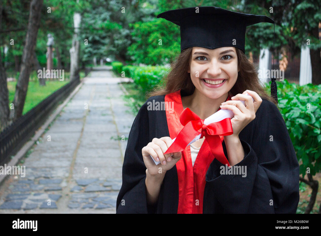 Woman portrait on her graduation day. University. Education, graduation and people concept. - Stock Image