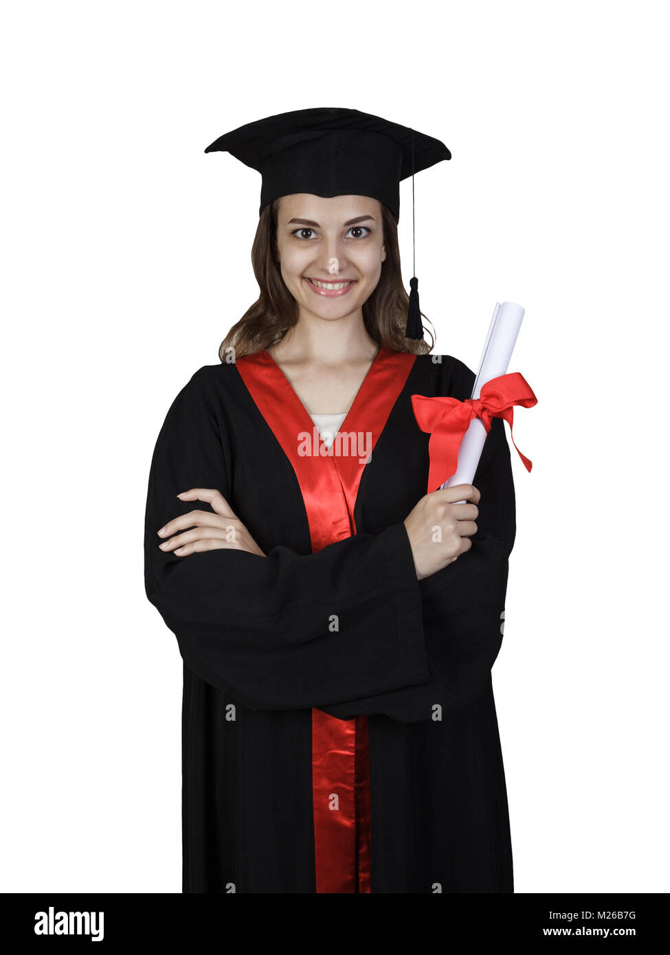 Female student in graduation gown holding books and a diploma isolated on white background. - Stock Image
