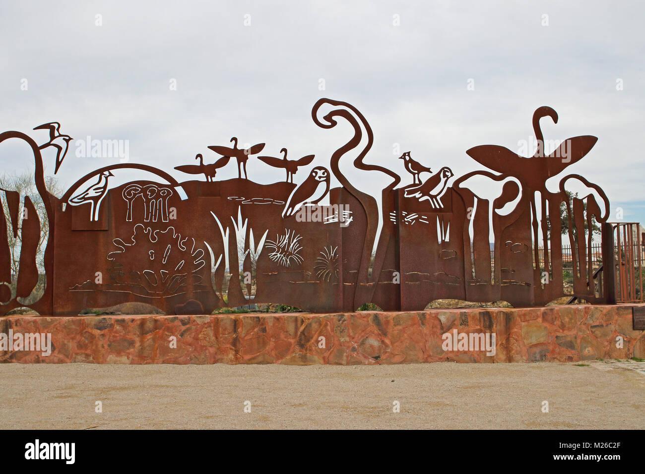 rusty iron artwork of birds  Jose Antonio Valverde visitor centre, Cerro del Palo  Laguna de Fuente de Piedra, Jaen, - Stock Image