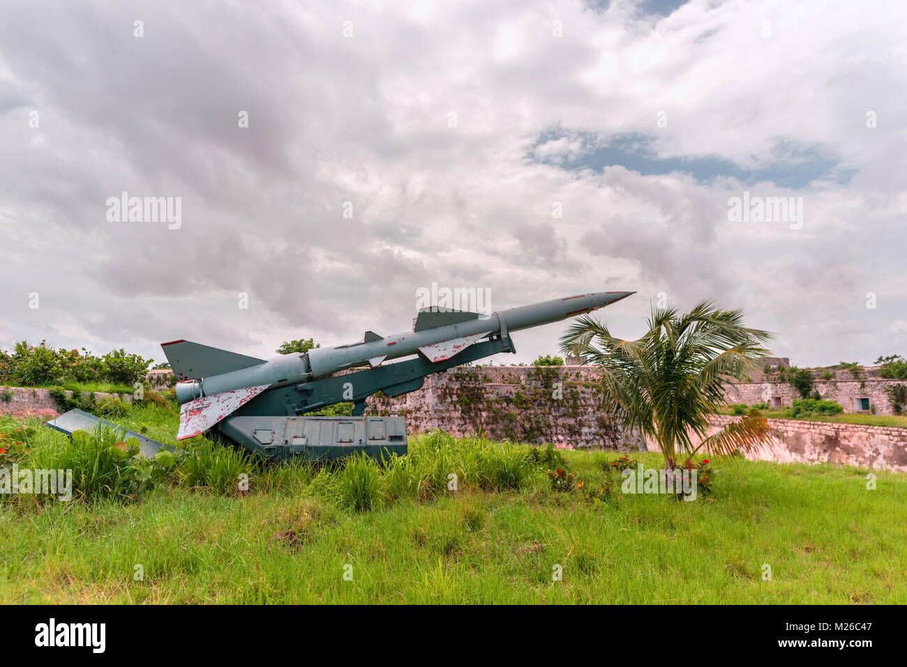 Military weapons, ballistic, anti-aircraft, medium-range missile complexes of ground-based in green grass, directed - Stock Image