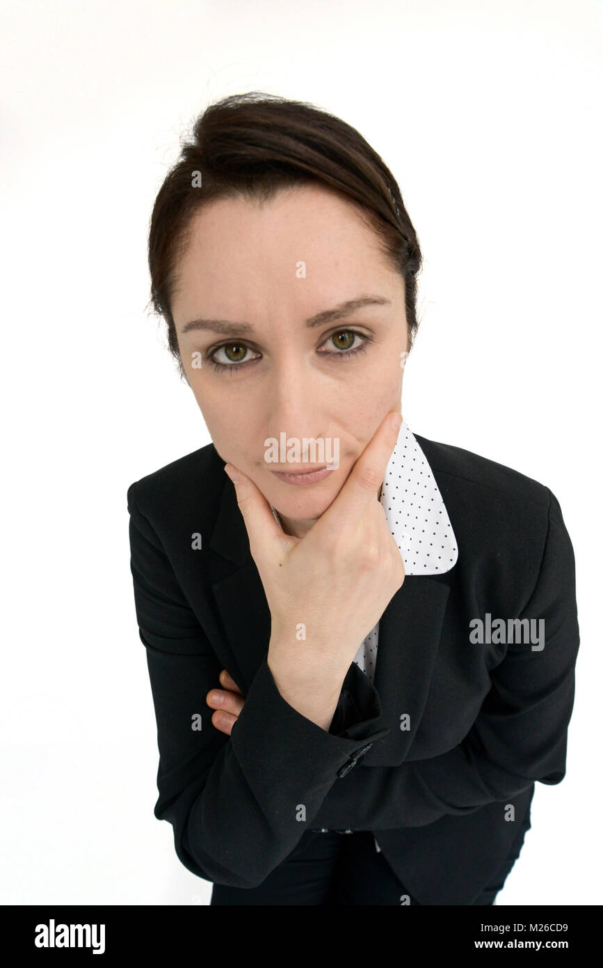a professional, smartly dressed attractive woman with facial expression isolated on a white background. Fair skin - Stock Image