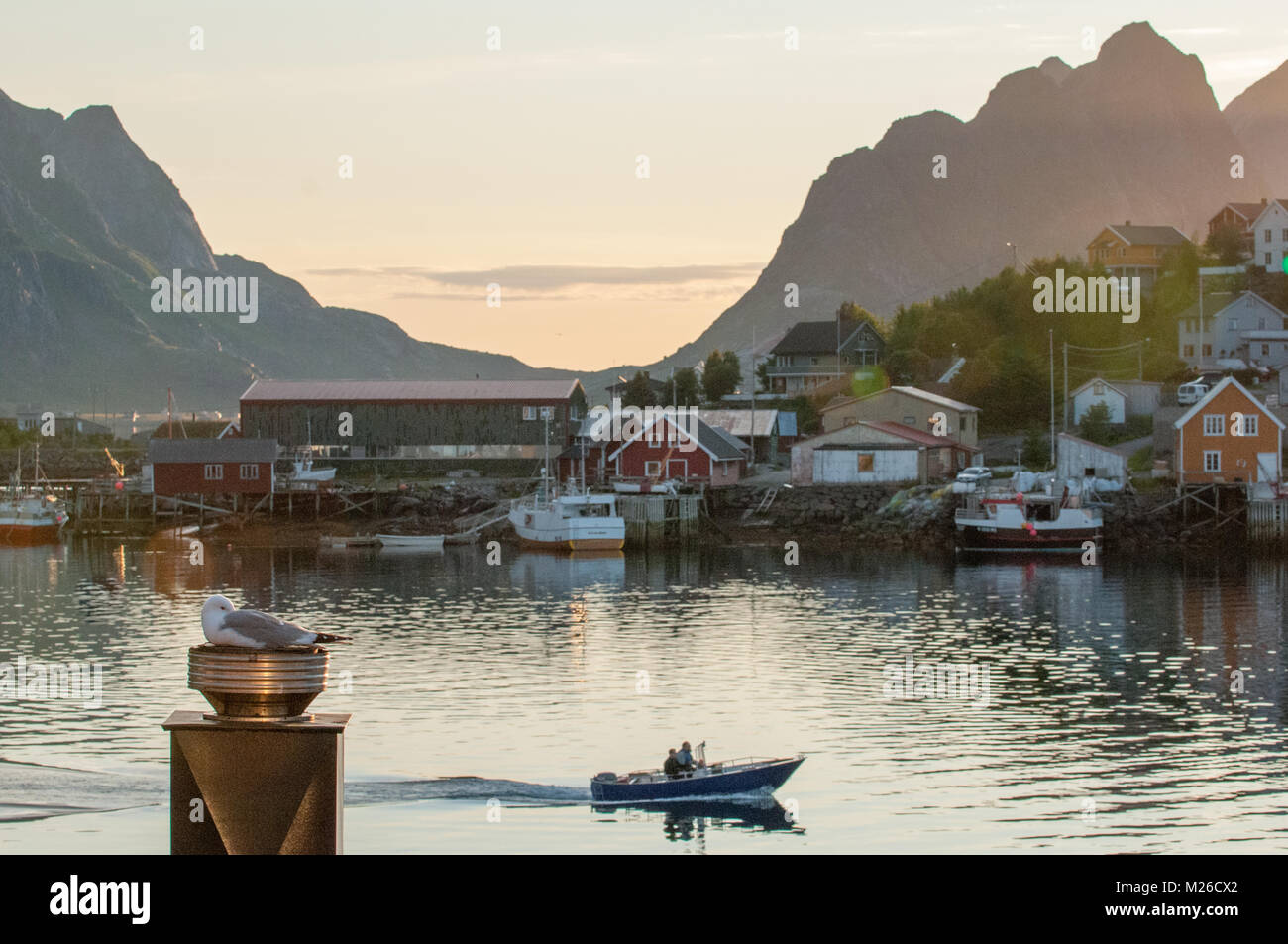 Nordic summer night in Reine at Lofoten islands in northern Norway. Reine is a picturesque fishing village and a - Stock Image