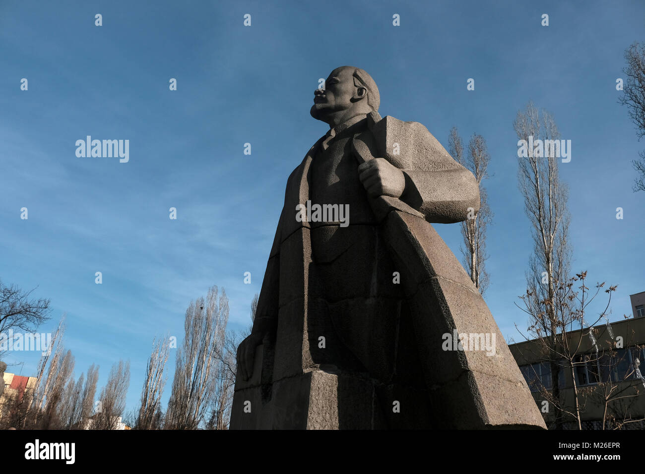 Soviet-era sculpted figure of Vladimir Lenin in front of the Museum of Socialist Art which covers the history of - Stock Image