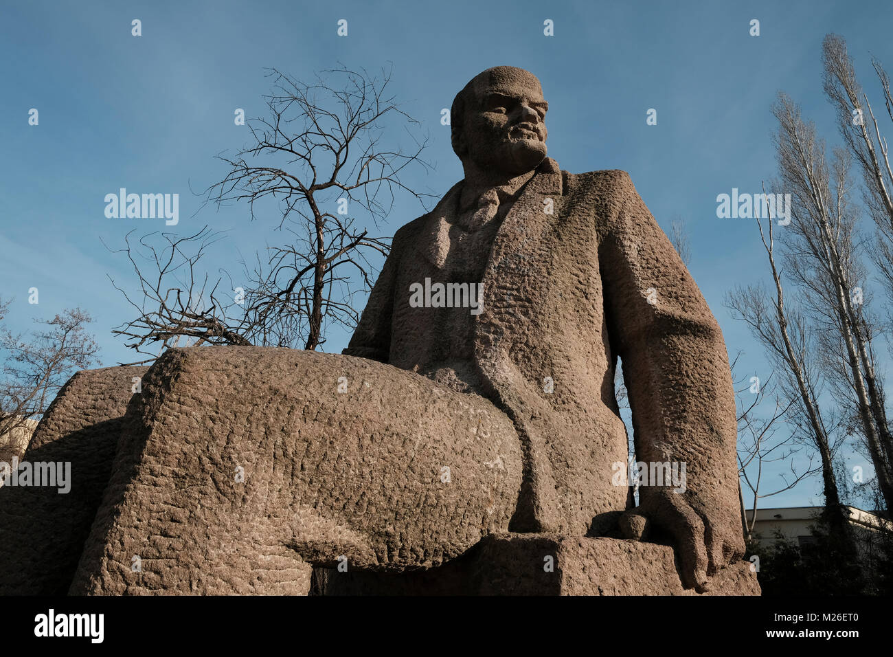 A Soviet-era sculpted figure of Vladimir Lenin in front of the Museum of Socialist Art which covers the history - Stock Image