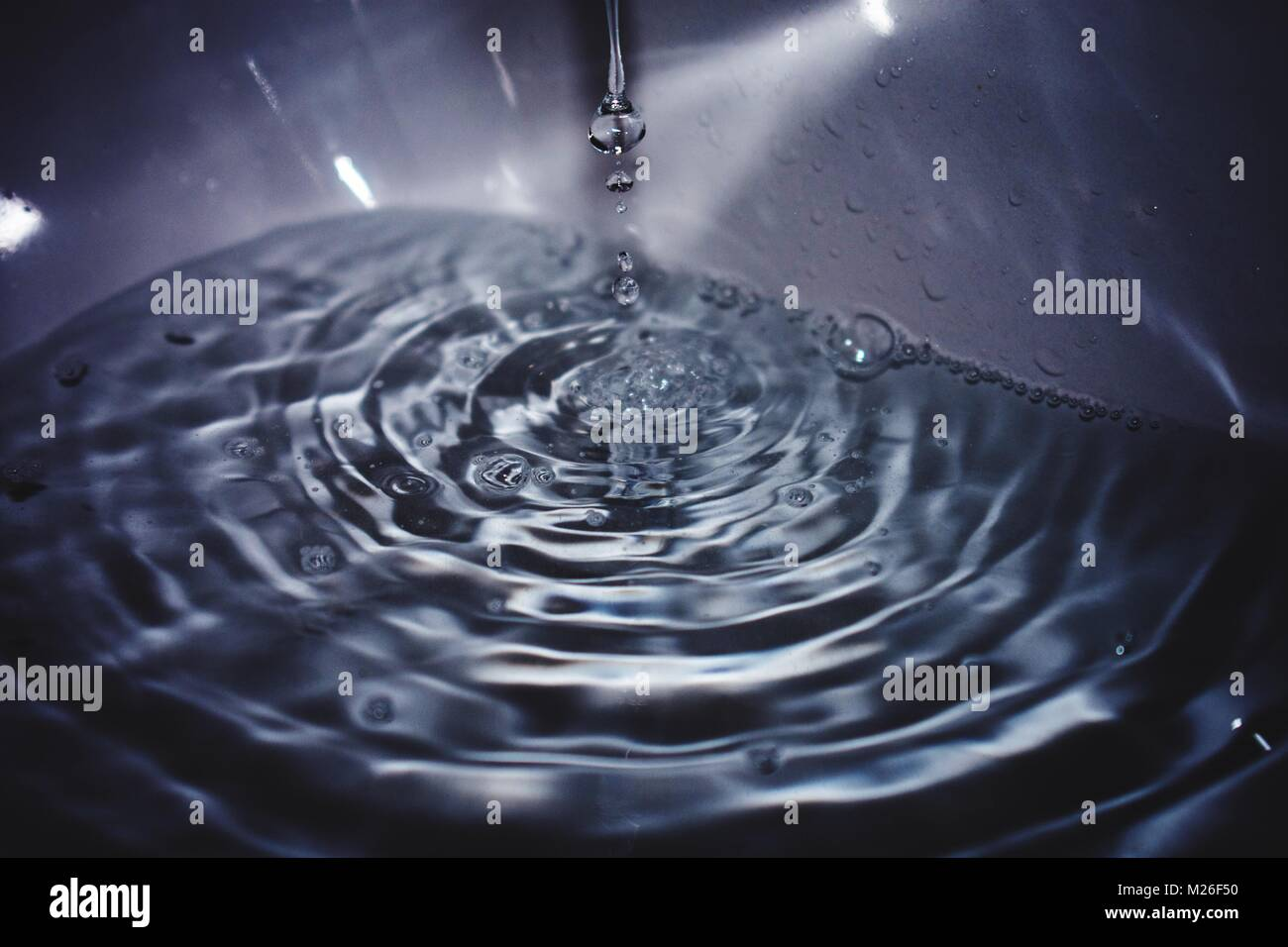Stop Motion Picture Of Water Running Into A White Sink