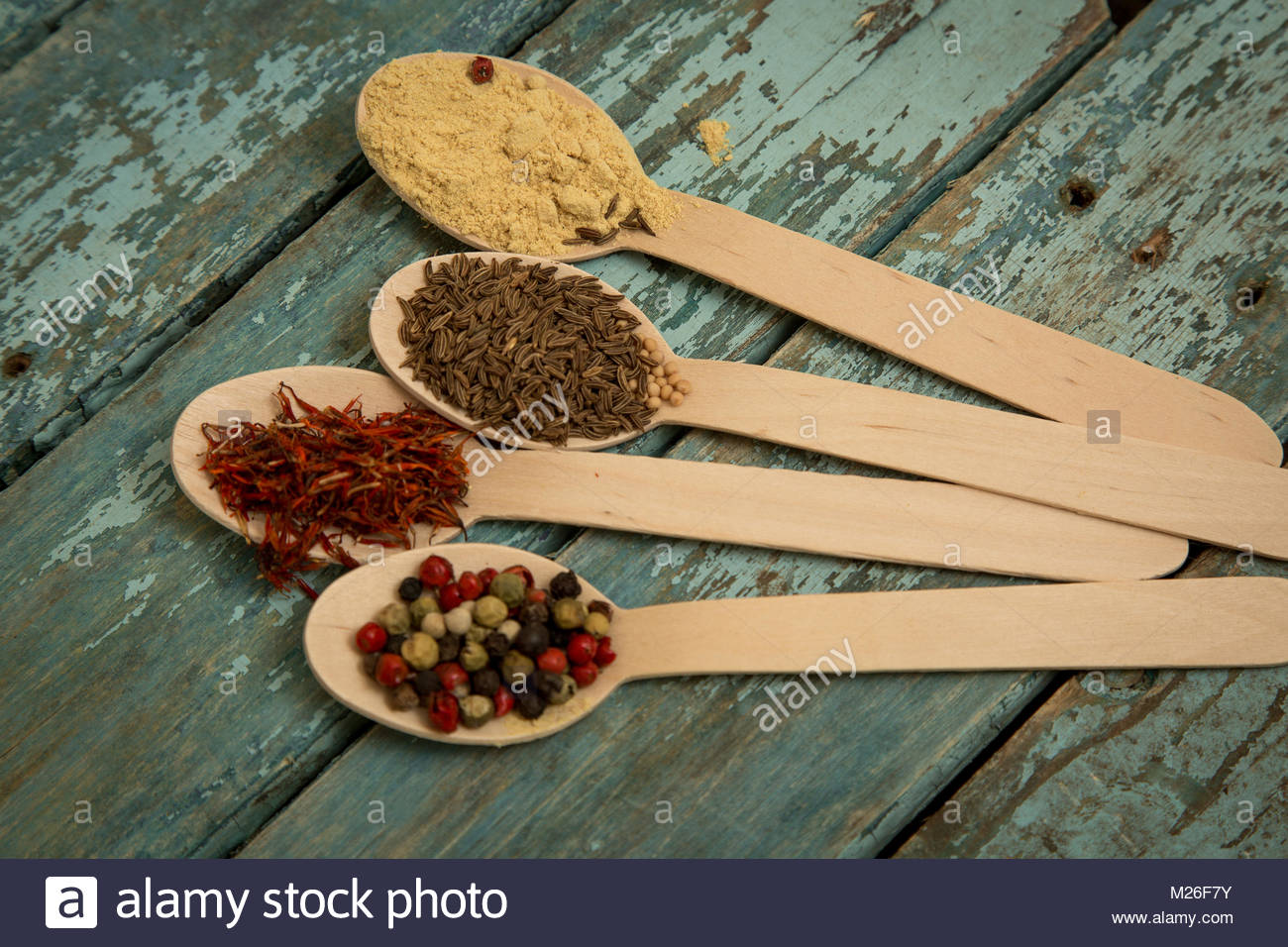 Mixed peppercorns in a wooden bowl - Stock Image