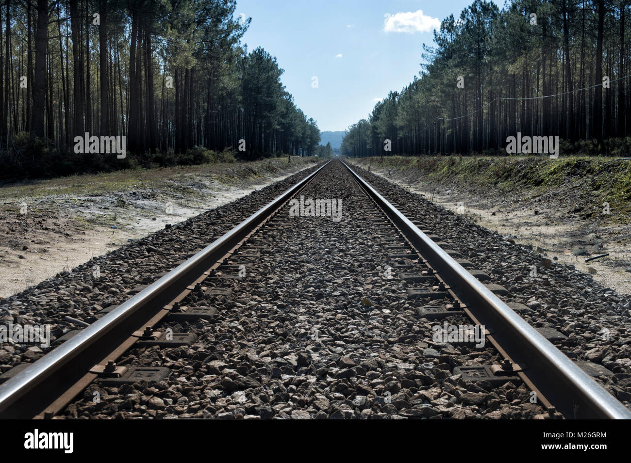 long straight railway tracks into the far distance. Perspective. - Stock Image