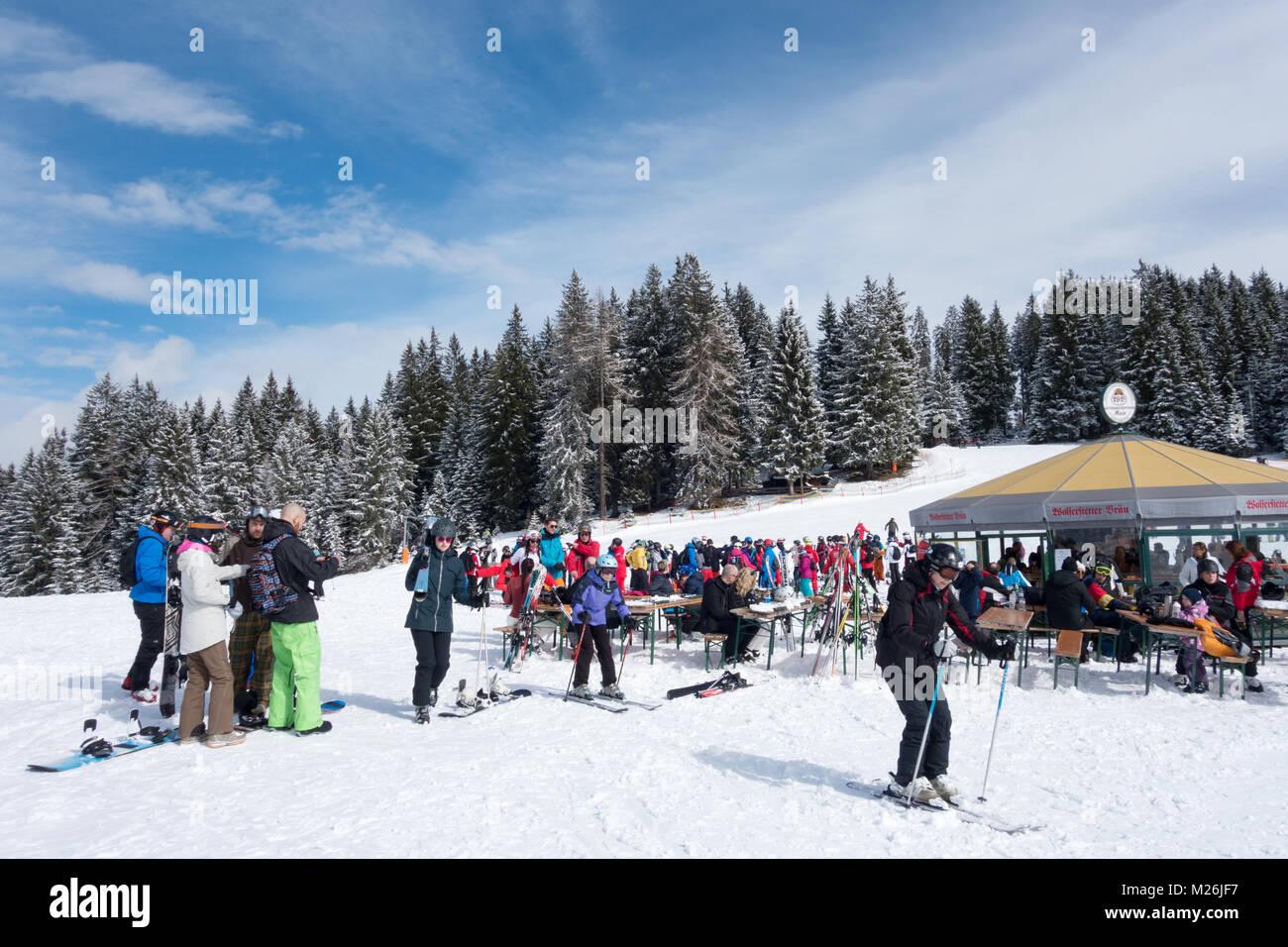 Skiers at a ski cafe on the ski slopes or pistes above Niederau, Alpbach, Tirol, Austria Europe - Stock Image