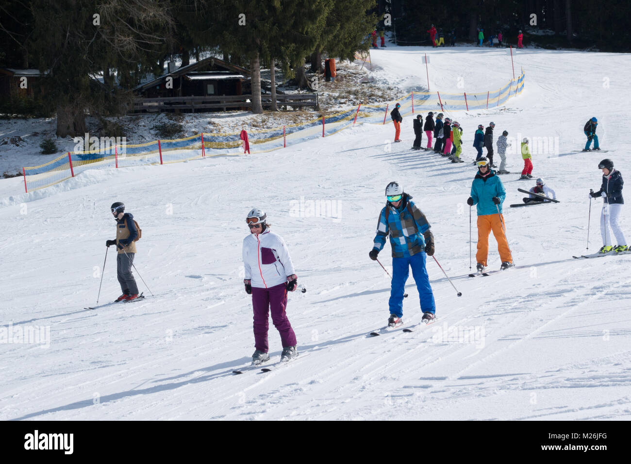 Skiers having a ski lesson on the nursery slopes, Niederau, Alpbach, Tirol, Austria, Europe - Stock Image
