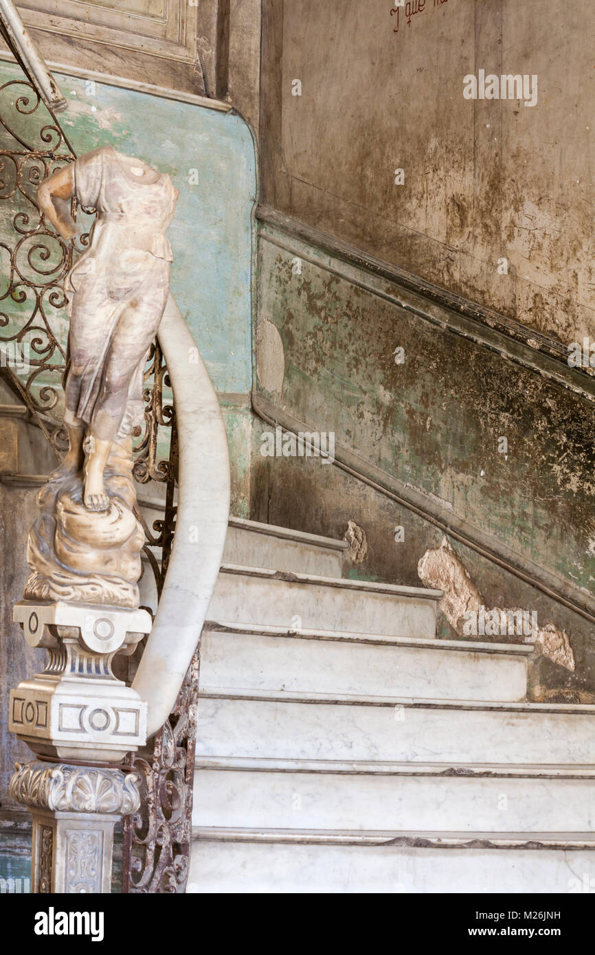 Ornate marble staircase to La Guarida Paladar Restaurant and statue in apartment building at Havana, Cuba, West - Stock Image