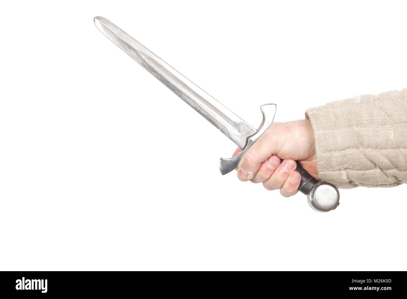 Medieval dagger in hand isolated on white - Stock Image