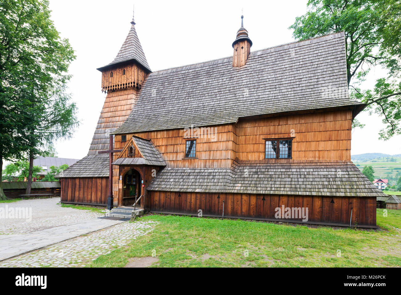Old Gothic wooden Church of St. Michael the Archangel in Debno Podhalanskie built in 1490. Sight entered onto UNESCO - Stock Image