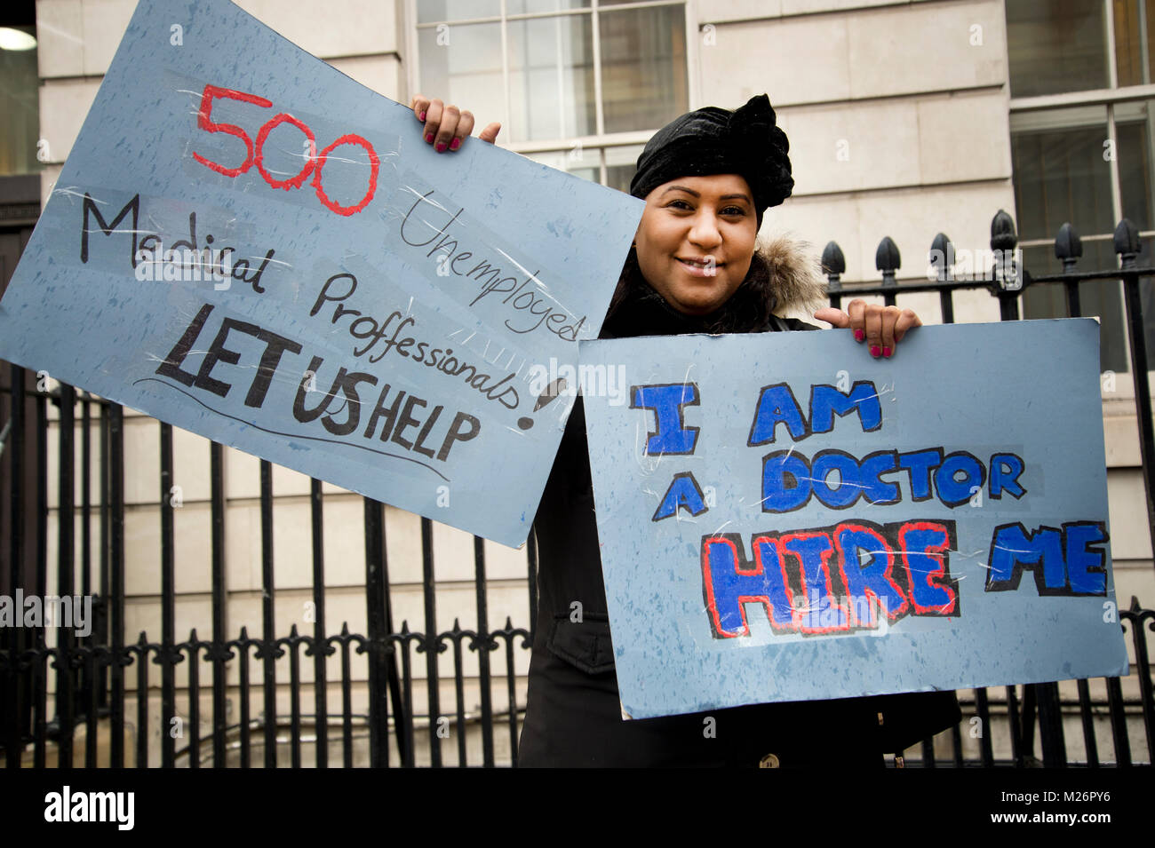 Demonstration called by the People's Assembly in support of the NHS . A doctor from Sudan holds a placard saying - Stock Image