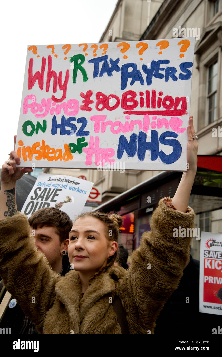 Demonstration called by the People's Assembly in support of the NHS . A placard asks  why tax payers are paying - Stock Image