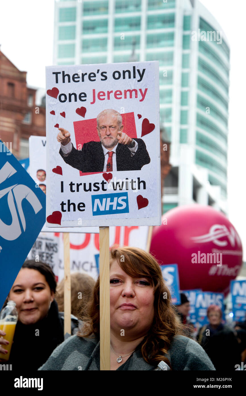 Demonstration called by the People's Assembly in support of the NHS (National Health Service}. A woman holds a placard with a photo of Jeremy Corbyn Stock Photo