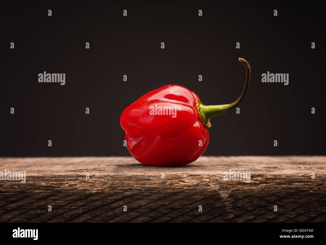 Hot and spicy Habanero chili on rustic wood Stock Photo