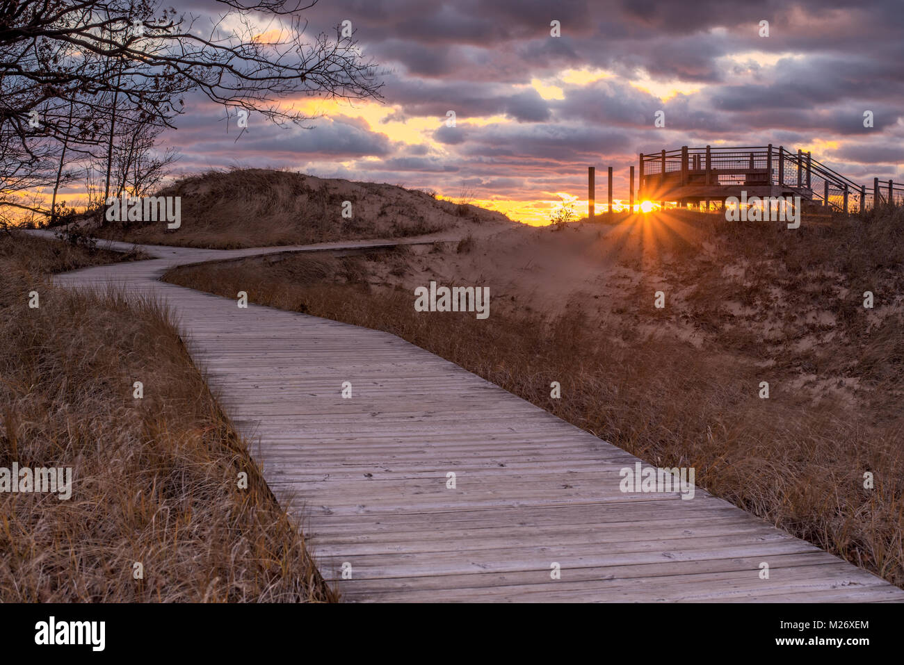A boardwalk in Michigan during sunset - Stock Image