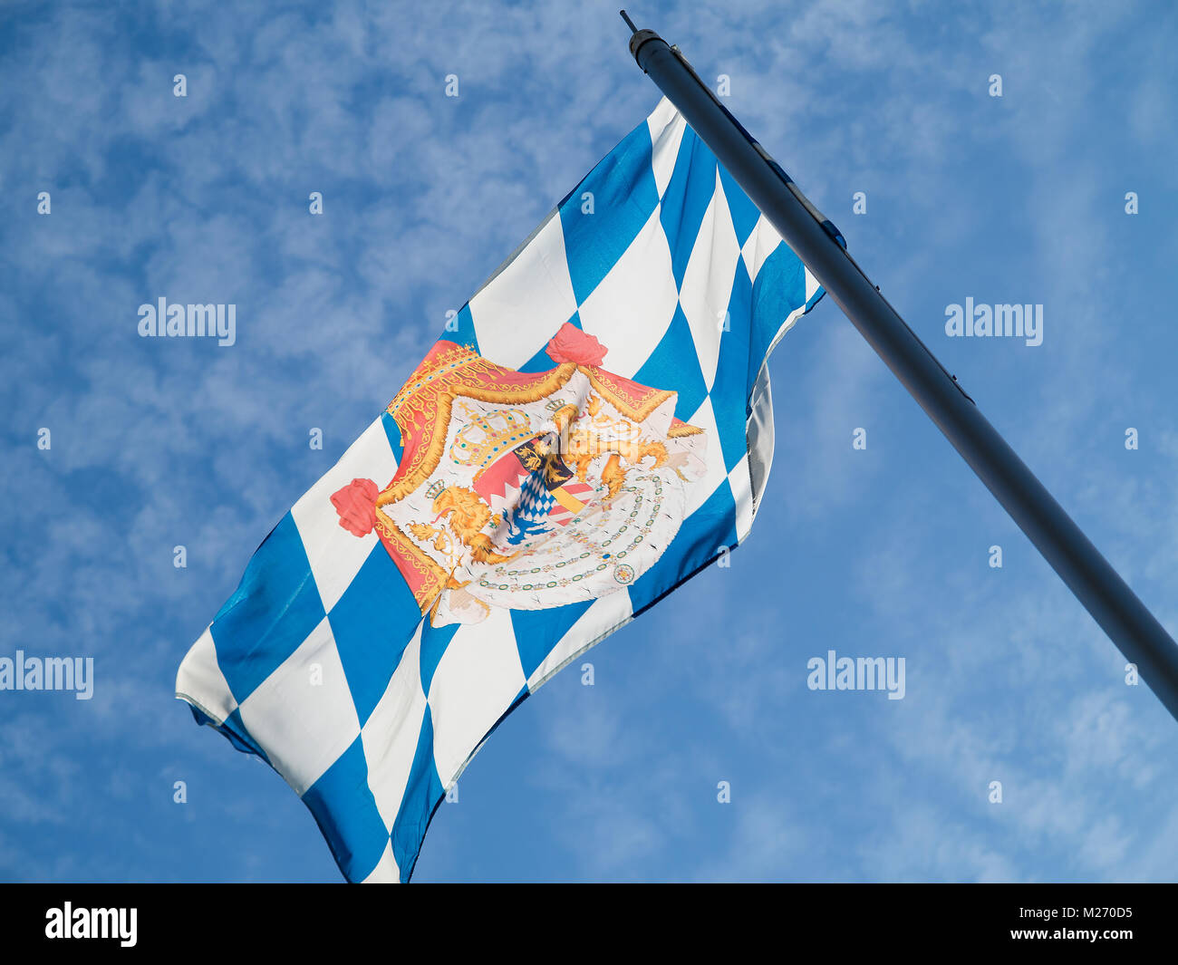 Bavarian flag in front of a summer sky - Stock Image