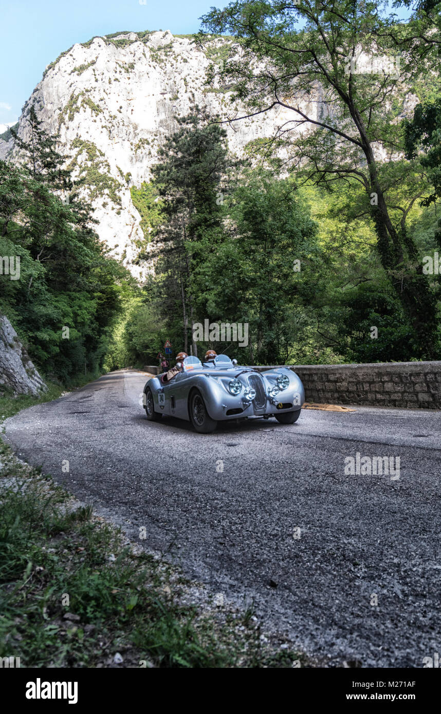 GOLA DEL FURLO, ITALY - MAY 19: JAGUAR XK 120 OTS LIGHTWEIGHT 1952 on an old racing car in rally Mille Miglia 2017 - Stock Image
