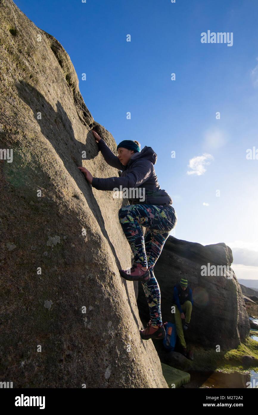 Female climber, Burbage Edge, Peak District, Derbyshire, Sheffield, England, UK Stock Photo