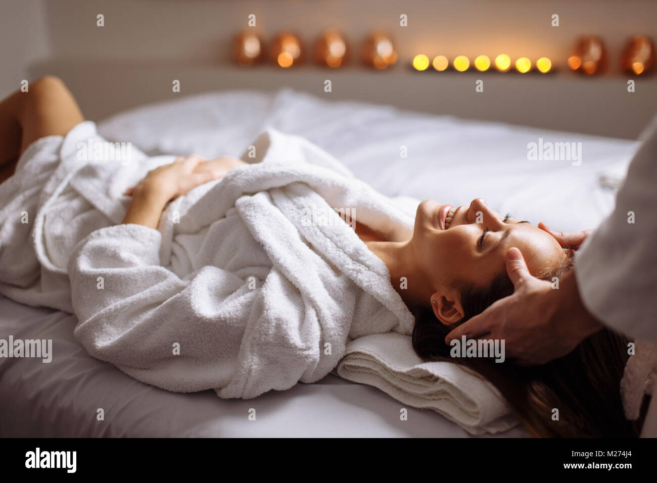 girl having spa facial massage in luxurious beauty salon Stock Photo