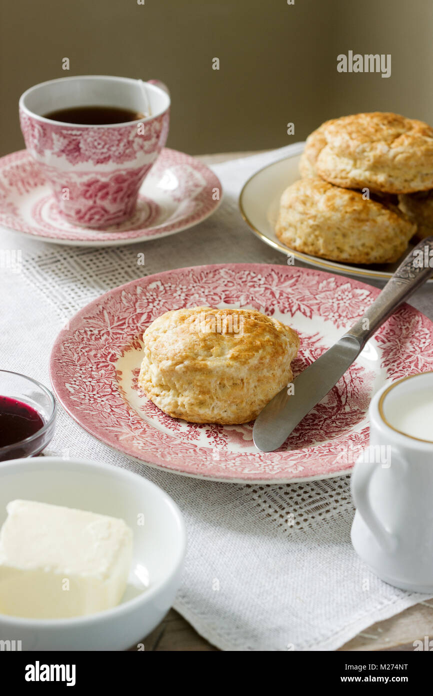 Homemade bread scones with hot tea, traditional British pastries. - Stock Image
