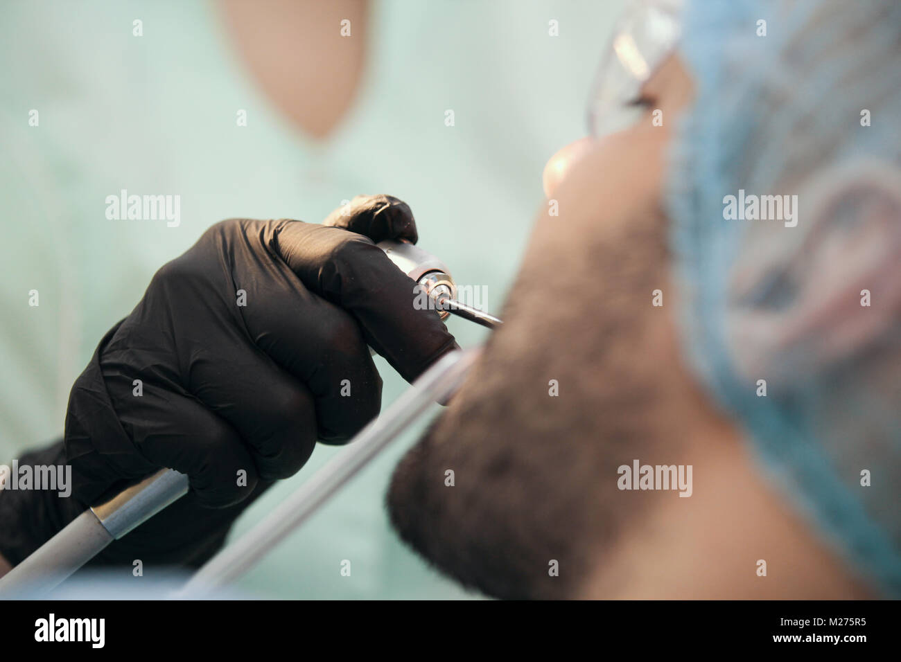Dentistry - male patient at stomatology clinic - Stock Image
