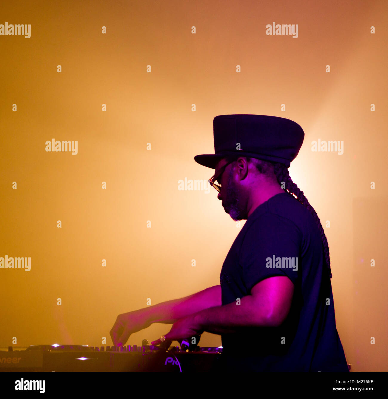Jazzie B performs on the decks at the Royal William Yard festival in Plymouth. - Stock Image