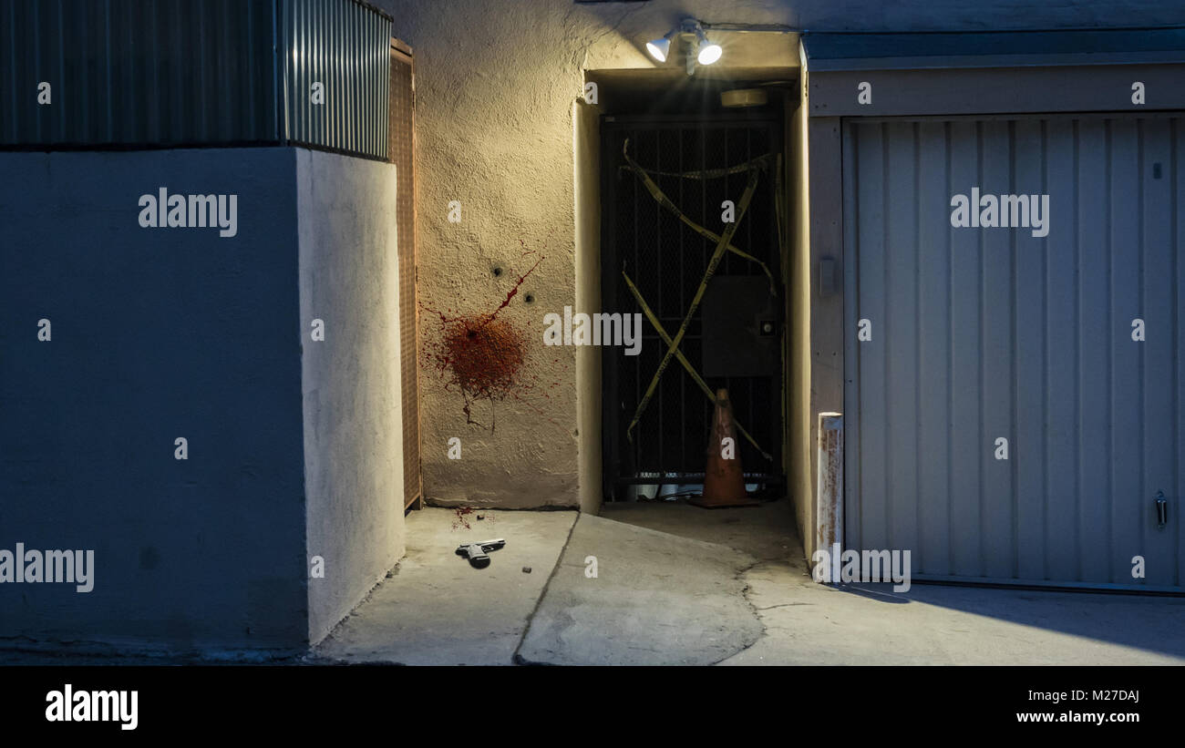 Bloody Crime Scene with a Handgun on the Ground - Stock Image