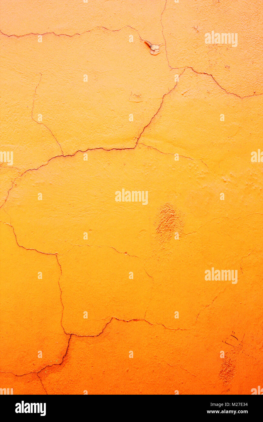 Grunge background with old stucco wall texture with cracked paint of