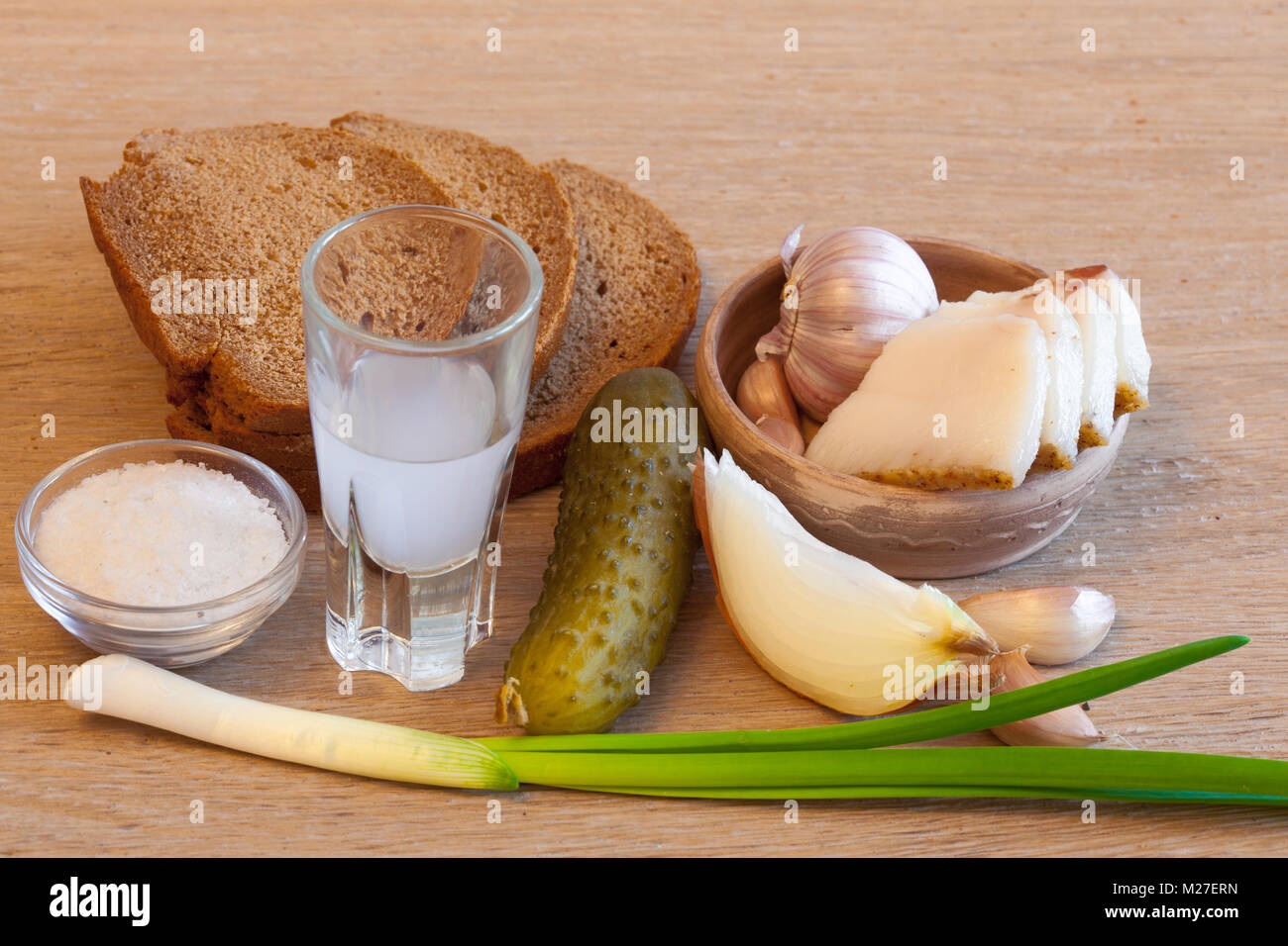 bread bacon and moonshine with onion lushy table for Russian - Stock Image