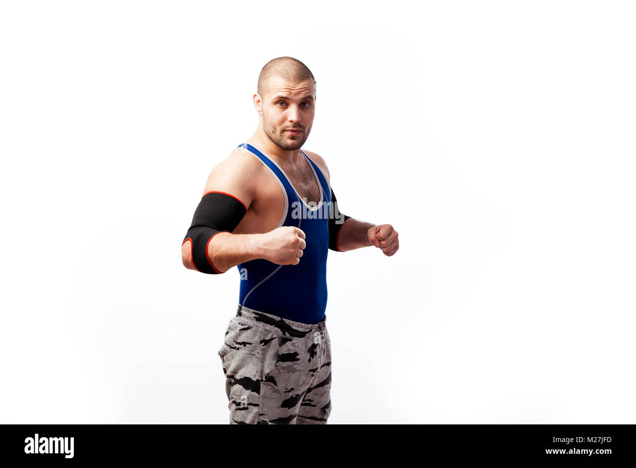 b3c4ce0e0da9d Young athletic man wrestler in a blue tank top