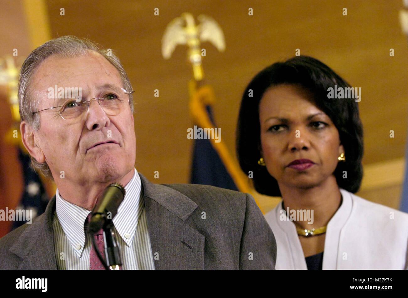 United States Secretary of Defense Donald H. Rumsfeld speaks to reporters as US Secretary of State Condoleezza Rice - Stock Image