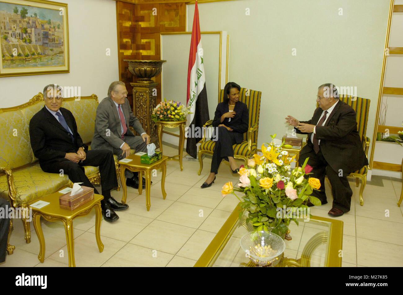 From left United States Ambassador to Iraq Zalmay Khalilzad, US Secretary of Defense Donald H. Rumsfeld and US Secretary - Stock Image