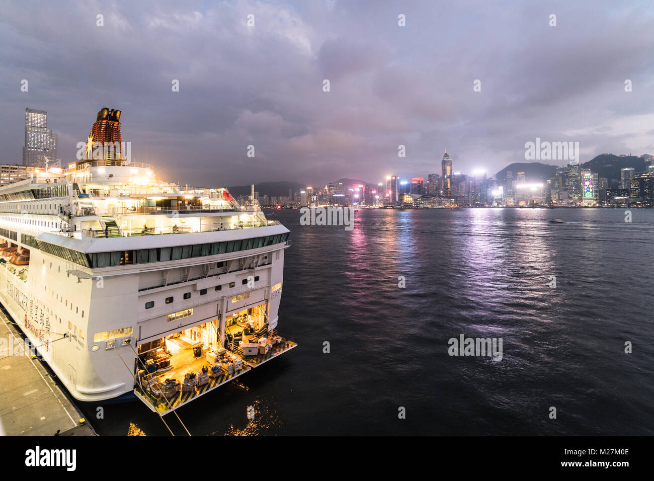 Hong Kong - January 25 2018: A large cruise ship anchored at the Ocean cruise terminal in Kowloon wiht the Hong - Stock Image