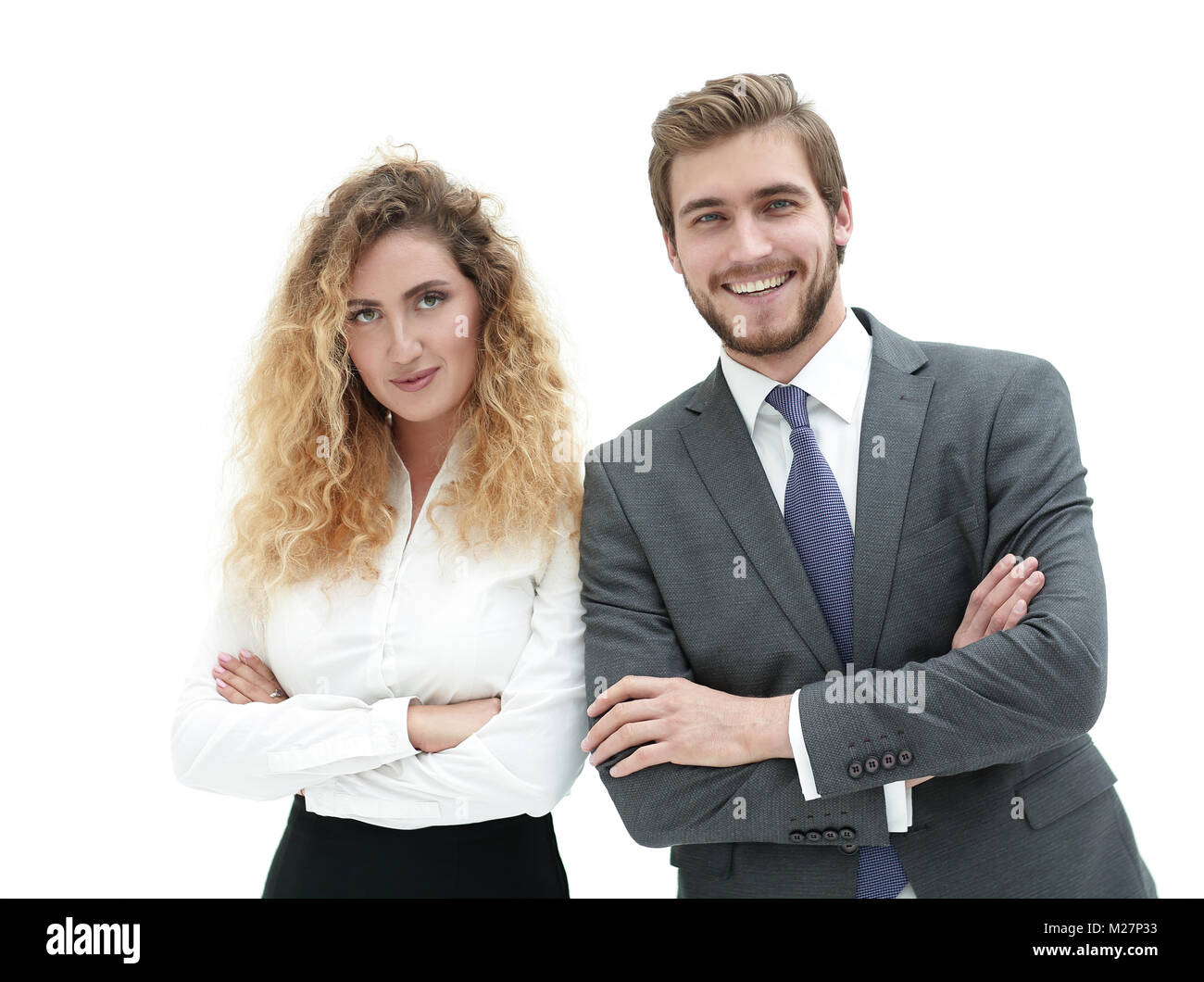two young business people stand with arms folded - Stock Image