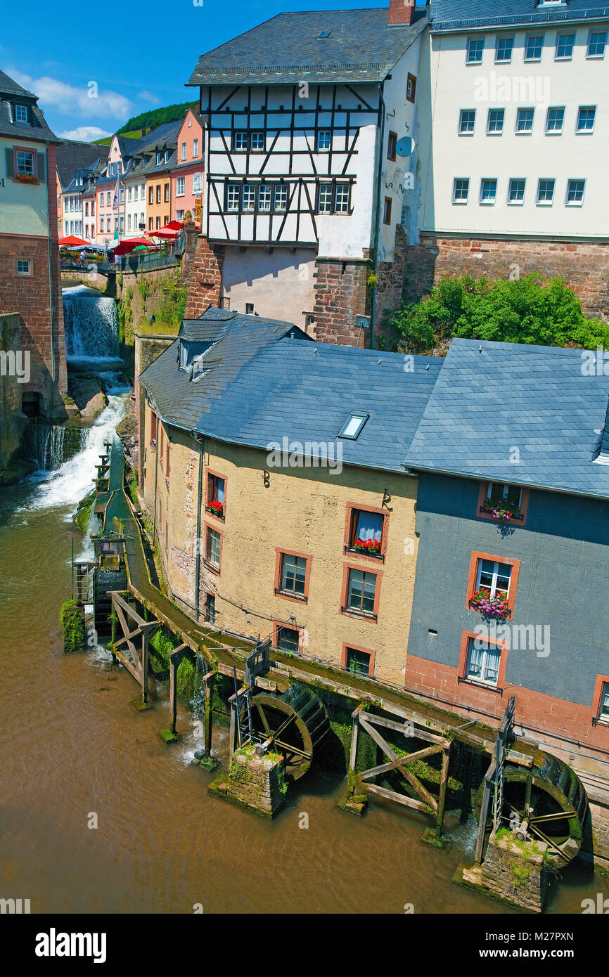 Historic water mills and buildings of 17. century at Leukbach stream, next to waterfall, old town of Saarburg, Rhineland - Stock Image