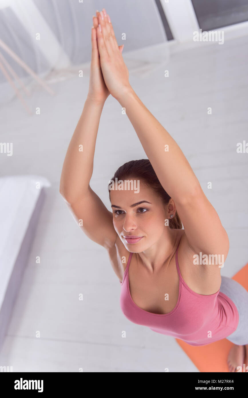 Content muscular fit woman doing yoga - Stock Image