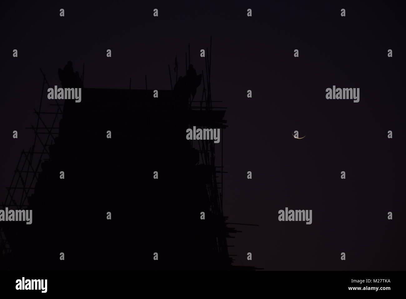 crescent moon over temple, sri lanka - Stock Image