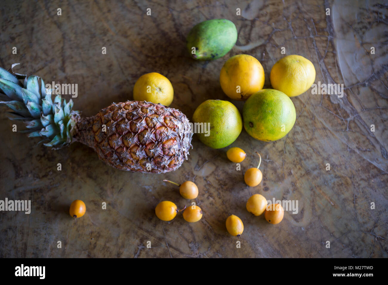 Still life of fresh tropical Brazilian fruits from the farmers market including pineapple, mango, and other local - Stock Image