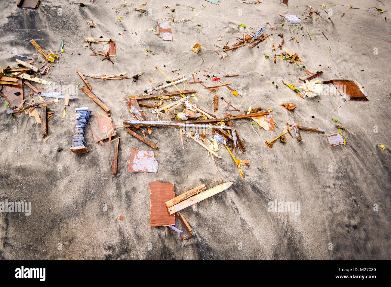 Bali, August 30, 2013: Sea funeral ceremony at Bias Tugel Beach in Bali - the coffin and its remains Stock Photo