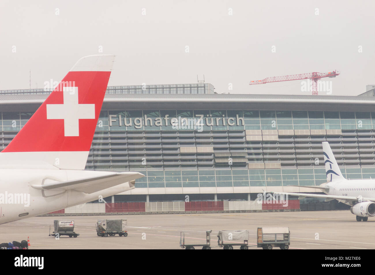 ZURICH, SWITZERLAND - DECEMBER 29, 2017: Fog in the Kloten Airport or Zurich International Airport. It is the largest - Stock Image