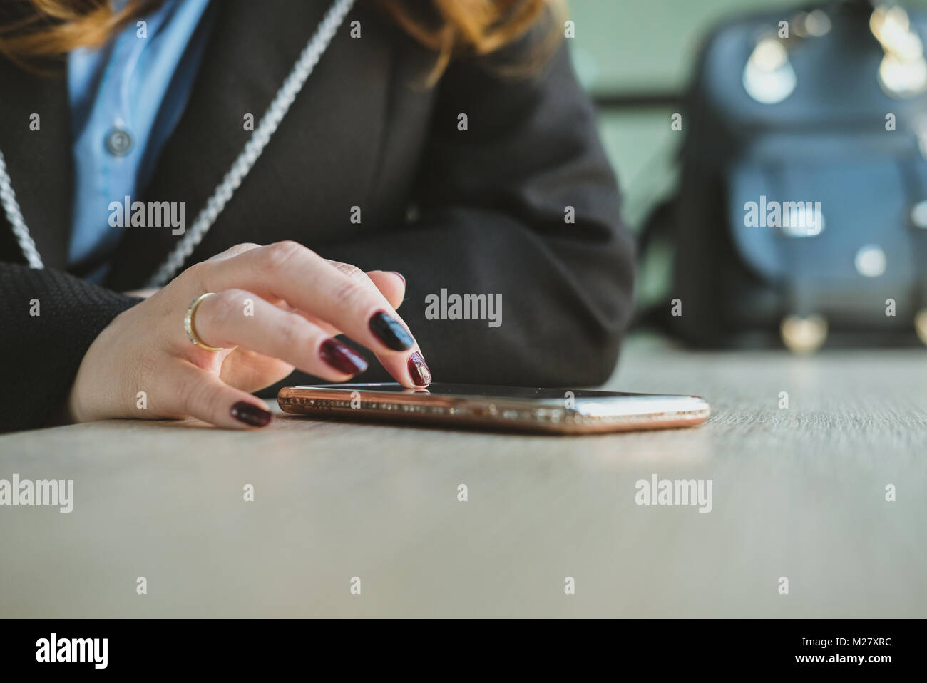 young businesswoman using app in smartphone at office. woman texting message at workplace. social network communication, - Stock Image